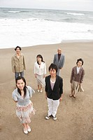 Family standing together at beach, portrait
