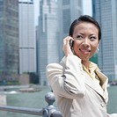 Close_up of a businesswoman talking on a mobile phone
