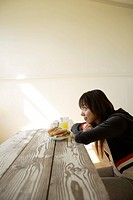 Young woman sitting with breakfast