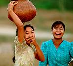 Young women carrying water bowl, Mrauk U, Rakhine State, Burma