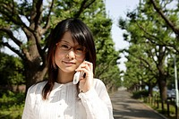 Portrait of a young woman talking on mobile phone