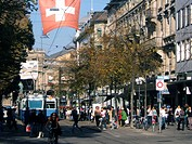 Switzerland, Zurich, Bahnhofstrasse, tram, swiss flag, people, spopping area