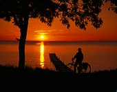 A cyclist by a sunset.