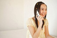 Teenage girl talking on mobile phone, side view