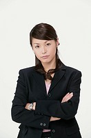 Businesswoman with arms crossed, portrait