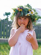 A girl wearing a midsummer wreath.