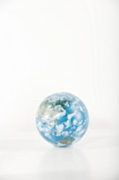 Globe on white background defocused