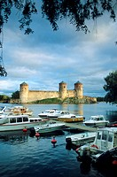 The Olavinlinna castle at Savonlinna lake at dusk, Karelia, Finland, Europe