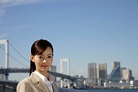Japan, Honshu, Tokyo, Young businesswoman smiling, portrait