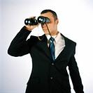 A man looking in a pair of binoculars.