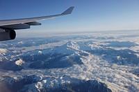 View through airplane window over Rocky Mountains, Oregon, USA