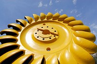 Yellow turbine wheel, Pelton turbine, water power plant near Loebbia, Bergell range, Grisons, Switzerland
