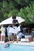 Young dark_skinned woman at the pool, Restaurant Nikki Beach, Ramatuelle, Saint Tropez, Cote d´Azur, South of France, France, Europe