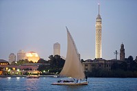 Feluka on the river Nile at dusk, Cairo Tower and opera house in the background, Cairo, Egypt, Africa