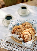Close up of coffee and croissants on table