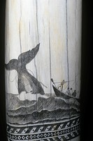 Scrimshaw carving of a whaling scene in the mid 1800s on a Sperm Whale tooth.