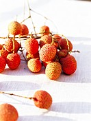 Litchi fruits on a table_cloth close_up.