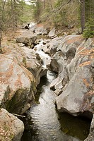 Water Erosion of and potholes in granite rocks, Sculptured Rocks Natural Area, New Hampshire, USA.
