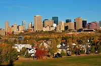 A fall landscape image of the downtown core skyscrapers in Edmonton along with some private homes in the capitol city