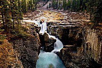 A horozontal image of the world famous Sunwapta Falls on the Maligne River in the world heritage site of Jasper National Park Alberta Canada.
