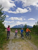 A family enjoys a casual bike ride on a stunning day near Valemount, Thompson Okanagan region, British Columbia Canada.