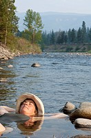 Woman cools off in the Nicola River, British Columbia, Canada