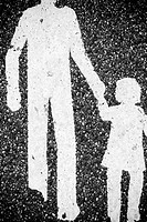 Close_up of a Pedestrian Crossing sign painted on a road