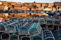 Lobster pots on quayside of coastal town, Whitby, North Yorkshire, England, december