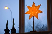 Lit up Christmas star in window