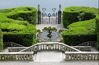 Steps, fountain and gates, in formal lakeside garden, Villa Carlotta, Tremezzo, Lake Como, Lombardy, Italy