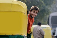 Man looking out of an auto rickshaw