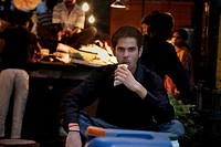 Man eating street food