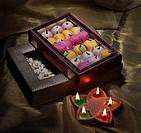 Box of sweets and nuts with diyas