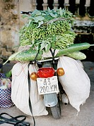 A moped packed with vegetables Vietnam.