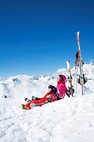 A mother and her son resting on the slopes.