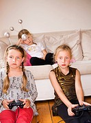 Three girls playing video game Sweden.
