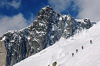 Touring skiers in a steep slope of the peak Le Petit Rognon in the Vallee Blanche, Haute-Savoie, France