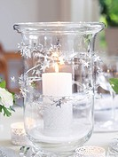 A candle on a decorated table Skane Sweden