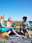 Women Having Picnic By The Sea Sweden.