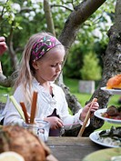 A girl peeling rhubarb Sweden.