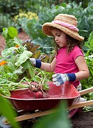 Mixed race girl gardening