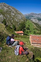 Hiker resting in the Invernales de Panizales, of the small town of Bejes, in the municipality of Cillorigo de Liébana, in Cantabria, Spain