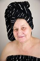 67 years old woman with a towel on her head