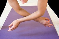 Woman doing yoga in a studio  Pose: 'Jnana Mudra'  MR