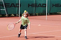 Model. 8_year_old boy playing tennis.