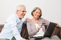 Mature couple using internet banking