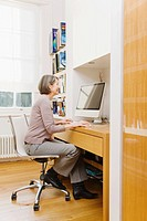 Mature woman using a computer