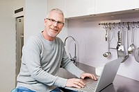 Mature man using laptop
