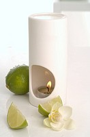 Aroma lamp, limes and orchid blossoms