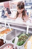 Girl choosing ice cream in an ice cream parlor
